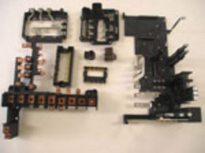 Motor parts with insert molding, production of the wiring board.
